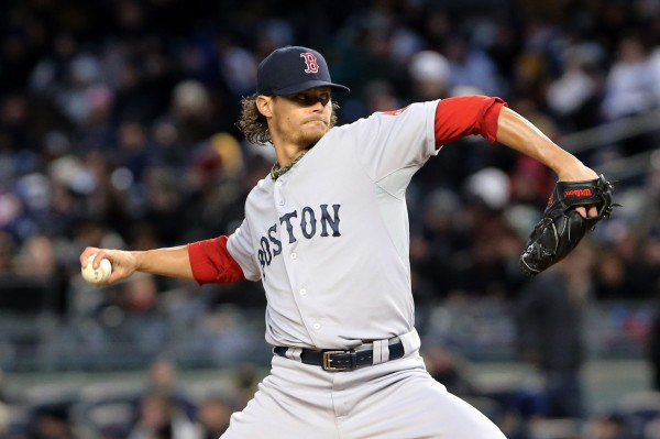 Boston Red Sox starter Clay Buchholz delivers a pitch during Wednesday night's game in New York against the Yankees. The Red Sox won 7-4.