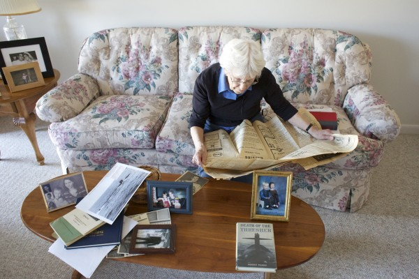 Valerie Buchanan of Bradley looks over an old newspaper article about her brother, the late Andrew Gallant, who was one of the crewmen who died when the USS Thresher nuclear submarine sank in 1963. The 50th anniversary of the April 10 sinking will be commemorated this weekend at Portsmouth Naval Shipyard.