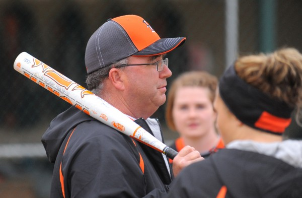 Brewer High School softball coach Skip Estes talks to the players during practice in Brewer.