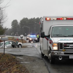 Driver cut out of car after crash with charter bus on Route 1