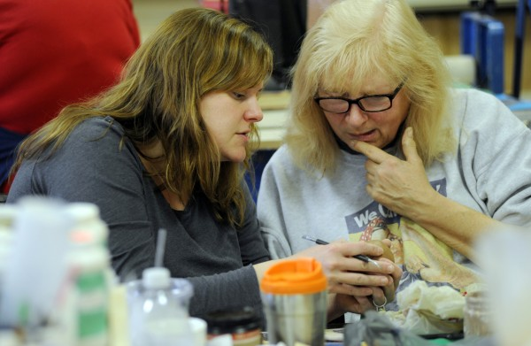 Lori Heagle (left), a volunteer at the Hammond Street Senior Center in Bangor, teaches three pottery class a week at the center for members like Pat Wyman (right). &quotWe really learn a lot,&quot said Wyman.