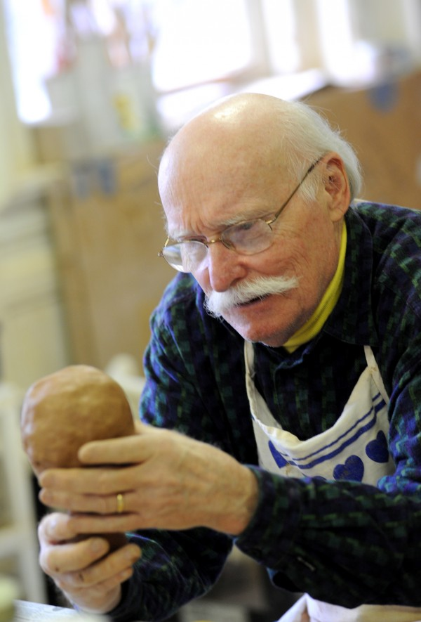 Al Banfield, a new member of the Hammond Street Senior Center, works on his first sculpture in a pottery class at the center. &quotI always wanted to do sculptures,&quot said Banfield.  &quotLearning is a lifelong thing.&quot