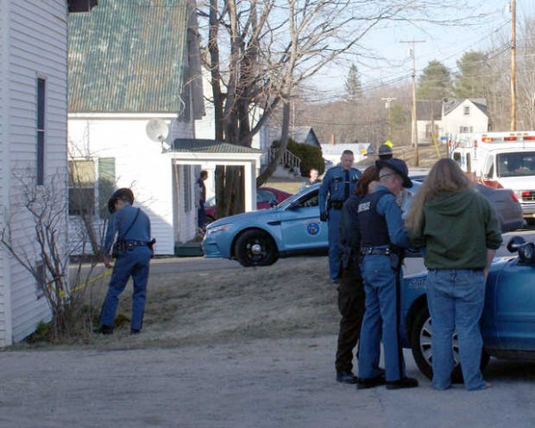 Maine State Police investigate the scene near 51 Depot St. where a woman was shot Monday night. The woman was taken by ambulance to a hospital. Police are investigating the incident.