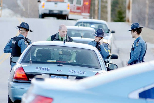 Maine State Police investigate a shooting at 51 Depot St. in Buckfield on Monday.