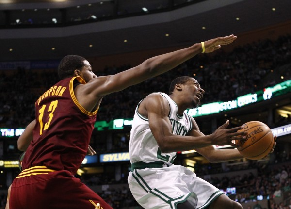 Boston Celtics shooting guard Jordan Crawford (right) shoots the ball against Cleveland Cavaliers power forward Tristan Thompson (13) during the second half at TD Garden on Friday.