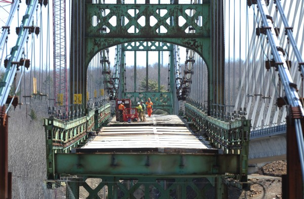 Workers prepare to sever a section of the Waldo-Hancock Bridge, which spans the Penobscot River between Prospect and Verona Island.