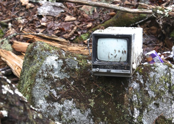 A small TV sits on a rock at the site that Christopher Knight, known locally as the North Pond Hermit, called home.