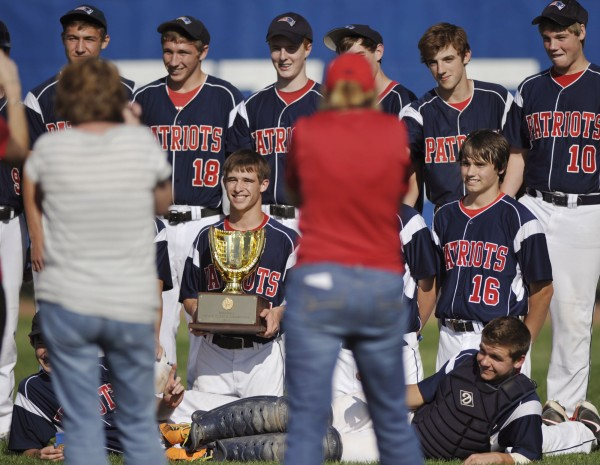 The Bangor Christian High School baseball team celebrate after defeating the Buckfield High School baseball team to win the state Class D championship in Bangor on Saturday, June 16, 2012.