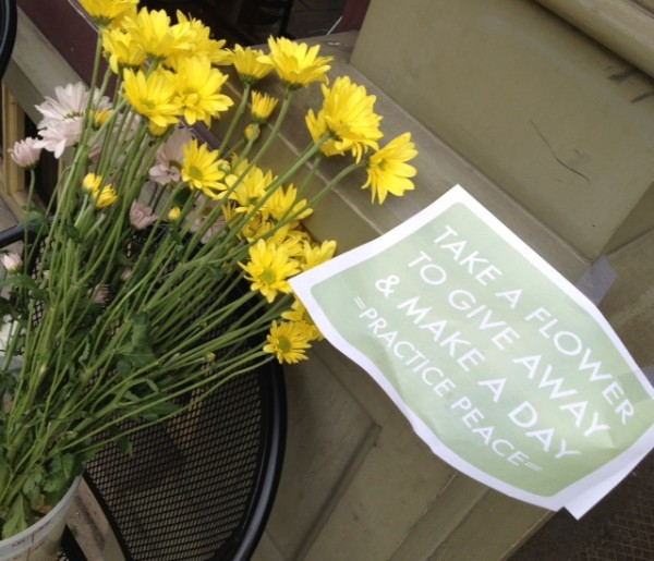 Free flowers outside Brew'd Awakening Coffeehaus in Lowell, Mass., were left by a patron Tuesday morning.