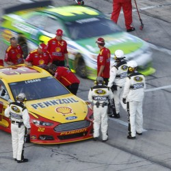 Joey Logano, 22, passes Mark Martin for Pocono Raceway victory