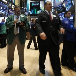 Dow marks first close above 15,000, S&P ends at record