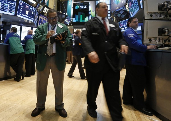 Traders work on the floor at the New York Stock Exchange, April 8, 2013.