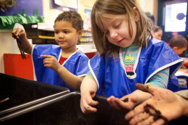 Josephine (left) and Emily learn about worms first hand at the Head Start program in Bath Tuesday.