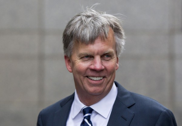 Ousted J.C. Penney CEO Ron Johnson smiles as he arrives at the New York state Supreme Court in Manhattan in this March 1, 2013, file photo. Johnson is out as CEO of the department store chain, which said on April 8 that former boss Mike Ullman would return as CEO less than two years after Johnson replaced him.