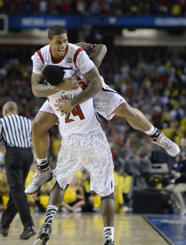Louisville Cardinals forward Montrezl Harrell (24) celebrates with forward Chane Behanan after beating Michigan 82-76 in the NCAA men's basketball final Monday night in Atlanta.