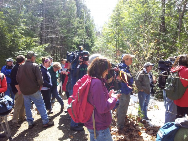 Media members and law enforcement officials en route to the campsite of the &quotNorth Pond Hermit&quot on Thursday.