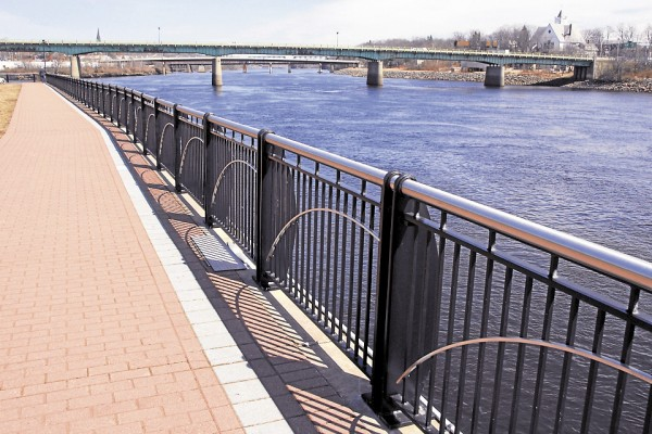 Making a rare appearance, the warm spring sun brightens the Penobscot River scenery at Bangor Waterfront Park on Friday, April 5. The park draws people all day to watch the river and its attendant wildlife or to bike or walk the various trails that cross the park.