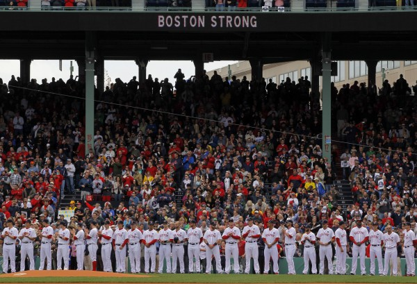 Boston Red Sox players stand on the field during a pre-game ceremony honoring the victims of the Boston Marathon bombings, before the team's game against the Kansas City Royals at Fenway Park in Boston, April 20, 2013.