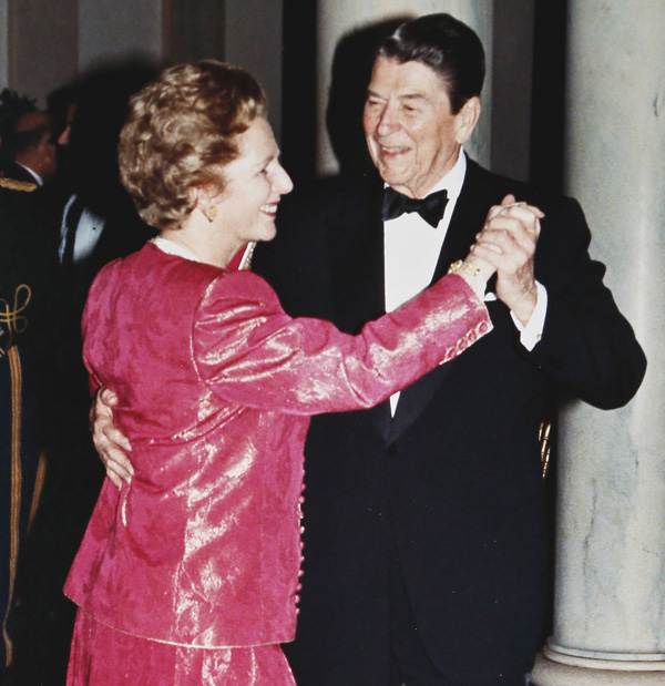 President Ronald Reagan and Prime Minister Margaret Thatcher take a spin around the dance floor in the foyer of the White House during a State Dinner in the Prime Minister's honor in this November 16, 1988, file photo.