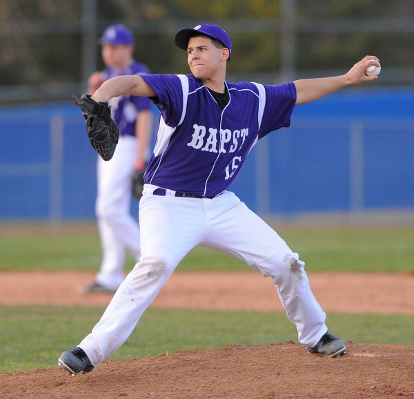 John Bapst's Shawn Curren pitches during the game against Old Town in Bangor Thursday.
