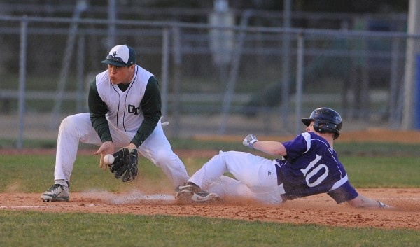 John Bapst's Andrew Catlin (right) slides to third base beating the throw to Old Town's Adam Boucher during the game in Bangor Thursday.