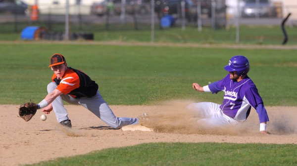 Hampden's Logan Steward (right) slides to second base beating the throw to Brewer's Tony Bissell during the game in Brewer Monday. Hampden won the game 6-3.