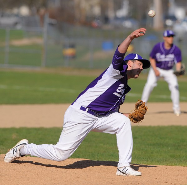 Hampden's Matthew Martin pitches during the game against Brewer Monday.  Hampden won the game 6-3.