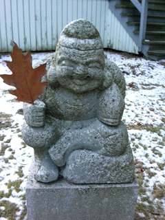 "A granite statue known locally as the ""Laughing Buddha"" was stolen from the lawn of a Bowdoin College building during the school's spring break."