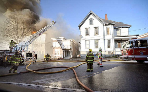 Firefighters from multiple departments cordoned off many downtown streets in Lewiston Monday as they doused fires in multiple apartment buildings. At least four apartment buildings on Bates, Blake and Pine Streets were involved, with many more in peril.