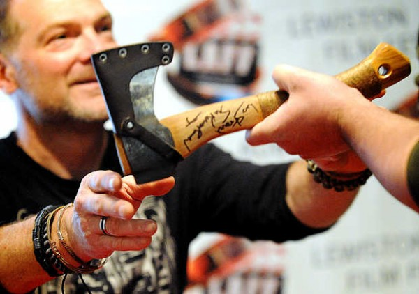 Les Stroud hands Eric Scribellito of Lewiston his autographed Wetterlings hatchet Thursday at Prose Gallery on Lisbon Street. Stroud, of the cable TV show &quotSurvivorman&quot was greeting fans during the kickoff to the Lewiston Auburn Film Festival.