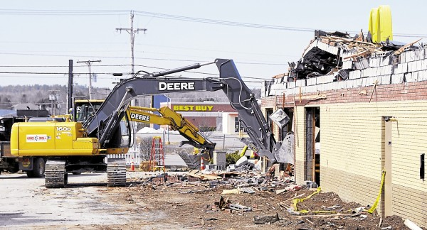 An excavator and heavy equipment operator from Hughes Bros Inc. tear out sections of the Hogan Road McDonald's in Bangor on Friday, April 5. The restaurant is being torn down to provide space for a new, modern McDonald's. Plans call for the new restaurant to be open in 90 days.