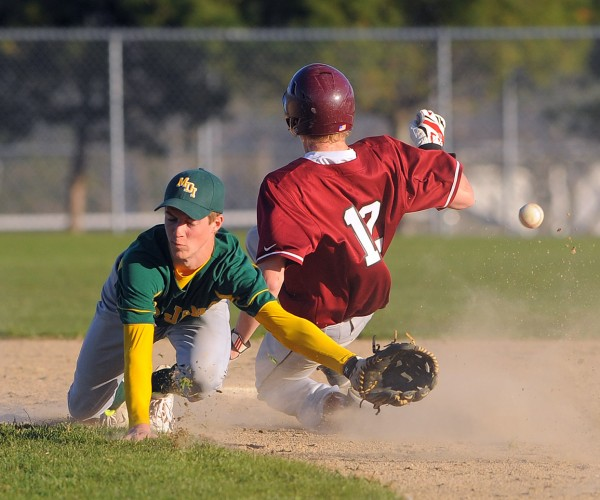 MDI's Jon Phelps (left) can't make the catch on the wide throw as Ellsworth's Steven Mahon slides to second base during the game in Ellsworth Tuesday.