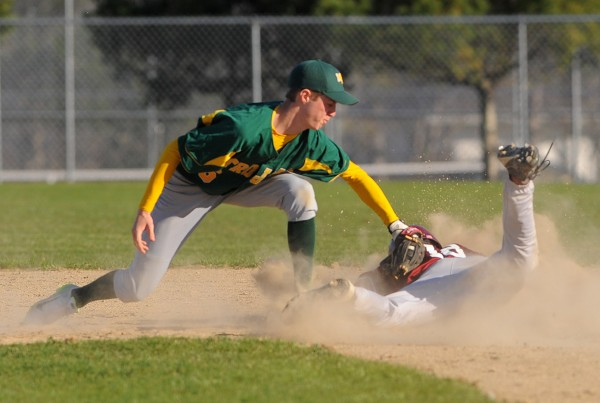 MDI's Jon Phelps (left) tags Ellsworth's Griffin Nightingale as he slides to second base during the game in Ellsworth Tuesday.