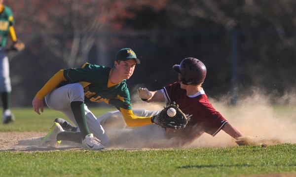 Ellsworth's Steven Mahon (right) slides to second base beating the throw to MDI's Jon Phelps during the first inning of the game game in Ellsworth Tuesday.