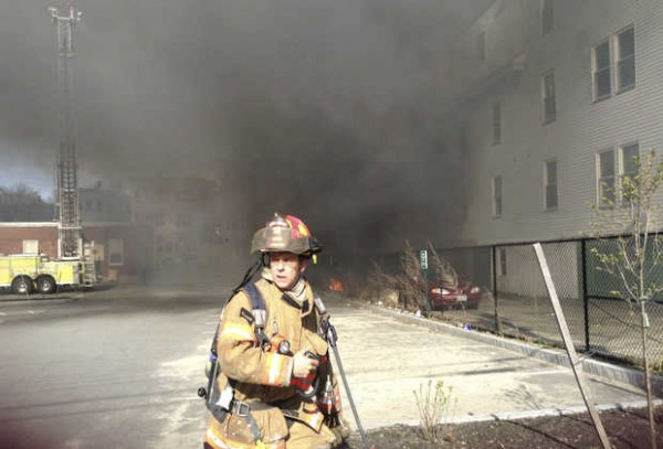 A firefighter on scene at the fire on Blake Street.