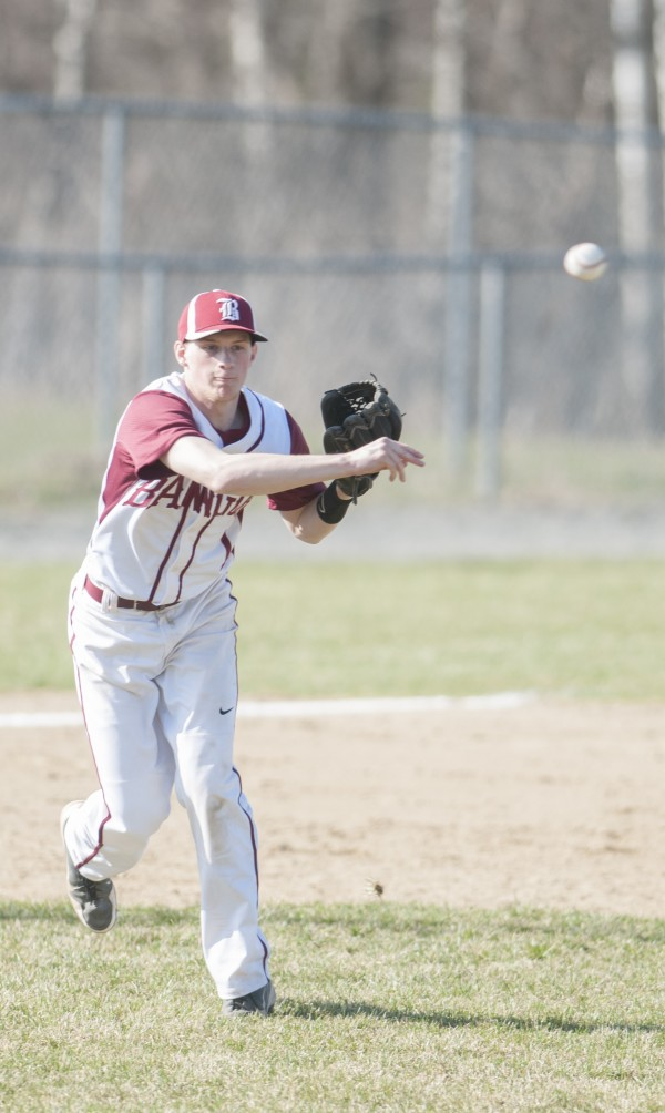 Bangor's Carl Farnham makes a throw to first base against Hampden on Friday, April 26, 2013.