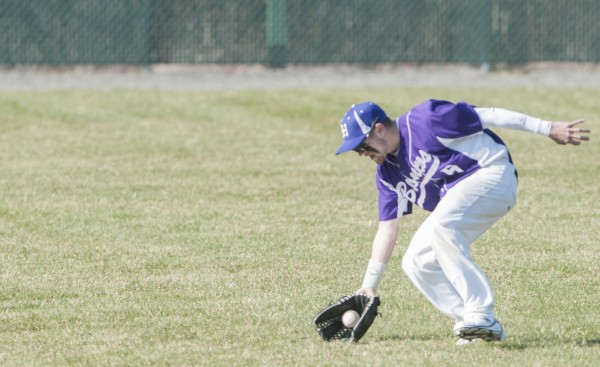 Hampden's Nick Rodgerson fields a ball hit to the outfield against Bangor on Friday, April 26, 2013.