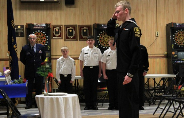 E-2 Faucett saluting the table after setting the rose.