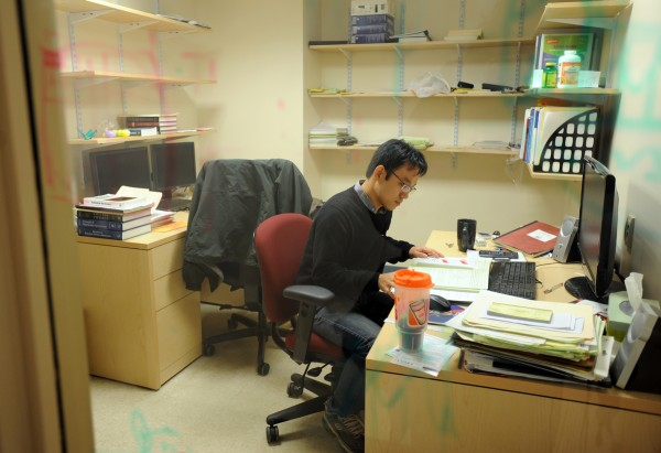 Dahan Kim, a graduate research assistant in the physics department at the University of Maine, works in his office in Clarence E. Bennett Hall on Thursday.