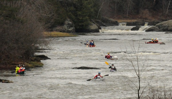 Boats make their way down the Kenduskeag Stream in Bangor during the 2013 Kenduskeag Stream Canoe Race.