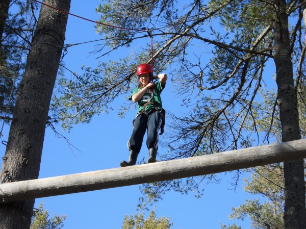 Middle school kids from Maine learn about teamwork on the adventure course at The Leadership School at Kieve.