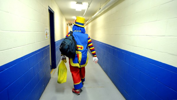Iggy heads down a hallway of the Bangor Auditorium to the Clown Room before the opening show of the 2013 Anah Shrine Circus. Andrew Matlins (Iggy) has been an Anah Shrine clown since 2002.