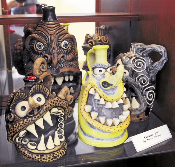 Steve Weslow's unique monster face pottery is one of the unique offerings at the Maine Jewelry and Art shop on Harlow Street in Bangor.