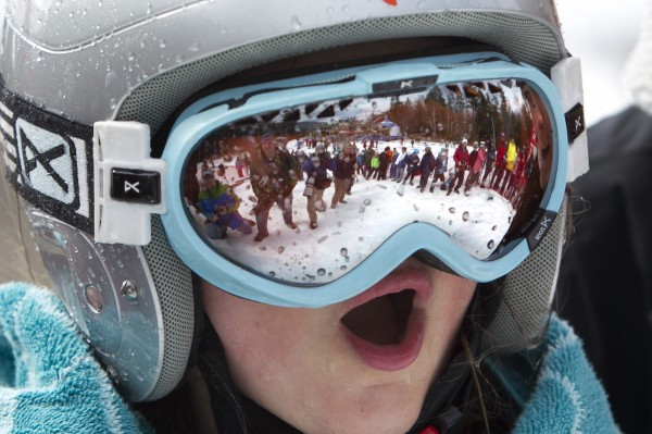 A found pond-skimmer's goggles reflect the crowd after she was pulled from the water after her unsuccessful attempt Sunday, April 7, 2013, at the Sunday River Ski Resort in Newry, Maine.