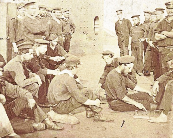 Crewmen of the USS Monitor lounge on the ironclad's deck not long after the ironclad's March 9, 1862, battle with the CSS Virginia. The sailor kneeling at the center of the photo and looking at the camera has been identified as crewman William Bryan; he died when the Monitor sank off Cape Hatteras on Dec. 31, 1862. Bryan was the great-great-great uncle of Andy Bryan of Holden.