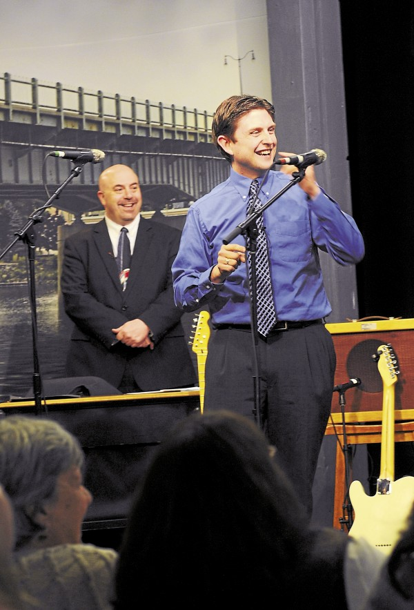 "Host Danny Cashman on stage. Behind him is announcer Joe Kennedy, ""the man with the golden pipes."""