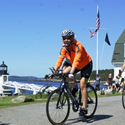 Pedal to the Port  cyclists enjoy breathtaking ocean views at Marshall Point Lighthouse in Port Clyde, during a rest stop in Trekkers' annual fundraising bike ride.