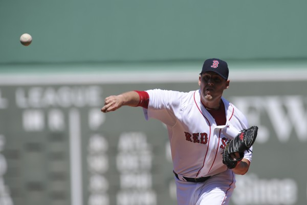 Boston Red Sox starting pitcher John Lackey pitches during the first inning against the Houston Astros at Fenway Park in Boston Sunday.