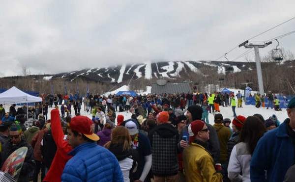 With the top of the mountain shrouded in clouds, the &quotbeach&quot at Sugarloaf, the area in front of the Carrabassett Valley resort's base lodge, is packed with people as they listened to music at the 25th annual Reggae Festival on Saturday.