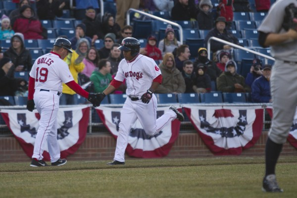 Heiker Meneses of the Portland Sea Dogs is congratulated by third base coach Kevin Boles after hitting a three-run home run in the second inning of Thursday's game against Trenton at Hadlock Field in Portland.
